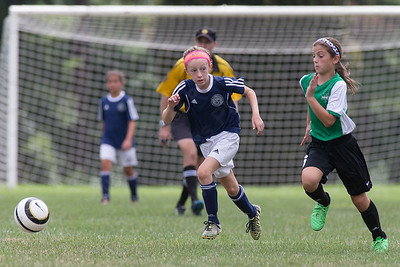Meriden's Molly Marcuss chasses down a pass as Wallingford's Sydney Cuticelli defends Sunday during the TWIST at Choate Rose Mary Hall in Wallingford Aug. 21, 2016 | Justin Weekes / For the Record-Journal