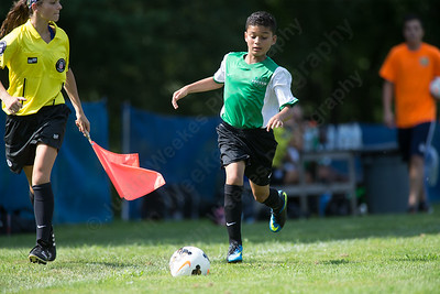 Wallingford's Jayden Quintero chases a loose ball Saturday during the TWIST Soccer Tournament in Wallingford Aug. 19, 2017 | Justin Weekes / For the Record-Journal