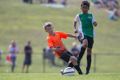 Wallingford's Adithya Nataraj gets challenged by Middletown's keeper Tyler Hahn Monday during the TWIST finals at Choate Rosemary Hall in Wallingford Aug. 21, 2017 | Justin Weekes / For the Record-Journal