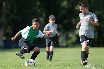 Wallingford's Jayden Quintero cuts back to beat a defender Saturday during the TWIST Soccer Tournament in Wallingford Aug. 19, 2017 | Justin Weekes / For the Record-Journal