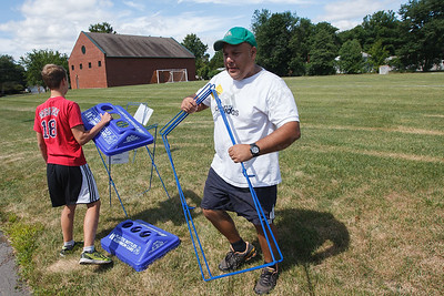 Jake Hutchinson 14 and Dave Rodriguez carry recycle receptacles to set up for TWIST Friday at Lyman Hall High School in Wallingford August,15 2014 | Justin Weekes / For the Record-Journal