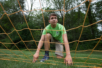 Tyler Stowik 16 stretches a net out to be staked Tuesday in preparation for TWIST Aug. 15, 2017 | Justin Weekes / For the Record-Journal