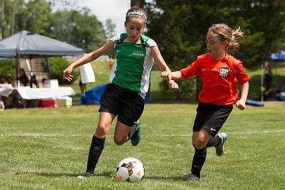 Wallingford's Lily Coish tries to get past CT Sol's Elle McCauley Sunday during the TWIST Soccer Tournament in Wallingford Aug. 20, 2017 | Justin Weekes / For the Record-Journal