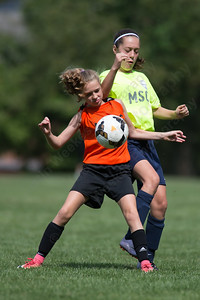 Meriden's Ava Perez back tries to get position on New York's Annie Maguire Monday during the TWIST finals at Choate Rosemary Hall in Wallingford Aug. 21, 2017 | Justin Weekes / For the Record-Journal