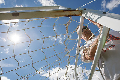 Bill Hutchinson ties a soccer net to the goal in preparation for TWIST Friday at Lyman Hall High School in Wallingford August,15 2014 | Justin Weekes / For the Record-Journal