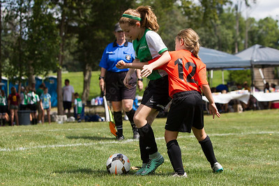 Wallingford's Ava Medeiros tries to get past CT Sol's Elle McCauley Sunday during the TWIST Soccer Tournament in Wallingford Aug. 20, 2017 | Justin Weekes / For the Record-Journal