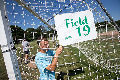 David Rodriguez attaches a field number sign to a soccer goal at Lyman Hall High School in preparation for the annual Wallingford Invitational Soccer Tournament Friday in Wallingford Aug. 19, 2016. T.W.I.S.T. will run through the weekend ending on Monday at various fields in town including Choate Rosemary Hall. | Justin Weekes / For the Record-Journal