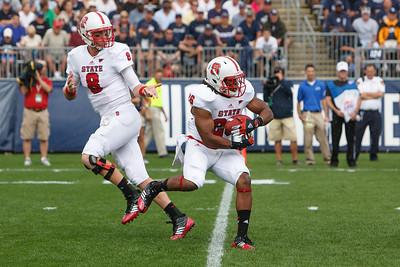 East Hartford CT Sept. 8 2012 Rentschler Field North Carolina State  quarterback  8  Mike Glennon hands off to North Carolina State  halfback  26  Tony Creecy