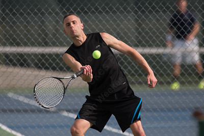 Steven Block od Cheshire returns a serve fromMatt Downes of Southington in a match Friday during opening day of the Wayton Open tennis tournament at Southington High School in Southington Jul. 8, 2016 | Justin Weekes / For the Record-Journal