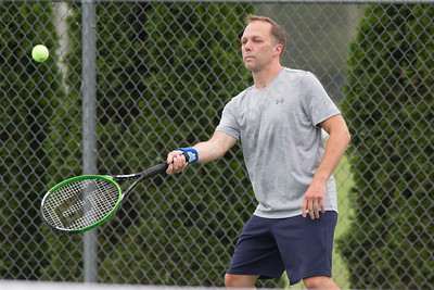 Everett Shaw of Cheshire plays a forehand volley in a mixed doubles match Wednesday during the Wayton Open at Southington High School in Southington Jul. 12, 2017 | Justin Weekes / For the Record-Journal