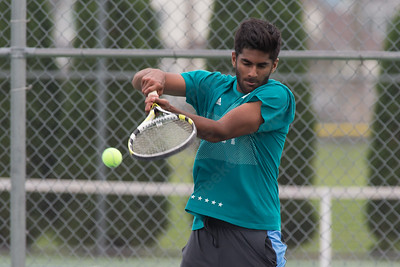 Abdulloah Choudhry of Cheshire plays a back hand volley in the mens B doubles Wednesday during the Wayton Open at Southington High School in Southington Jul. 12, 2017 | Justin Weekes / For the Record-Journal