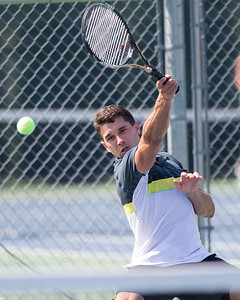 Joe Albiach plays a forehand volley in the mens A final with Kunal Kataria Sunday during the Wayton Open finals at Southington High School in Southington Jul. 17, 2016 | Justin Weekes / For the Record-Journal