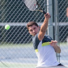 Joe Albiach plays a forehand volley in the mens A final with Kunal Kataria Sunday during the Wayton Open finals at Southington High School in Southington Jul. 17, 2016   Justin Weekes / For the Record-Journal