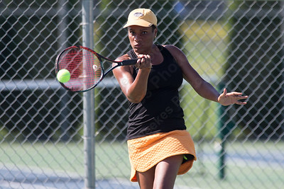 Opal Bravo of Bloomfield returns a volley from Ellie Doolittle in the women's singles match Sunday during the Wayton Open Tennis finals at Southington High School in Southington Jul. 16, 2017 | Justin Weekes / For the Record-Journal