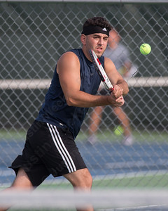 Kreshnik Bytyqi of Waterbury plays a back hand volley Friday during opening day of the Wayton Open tennis tournament at Southington High School in Southington Jul. 8, 2016 | Justin Weekes / For the Record-Journal