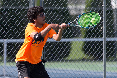 Rohan Kataria 15 of Southington plays a volley in the A doubles final Sunday during the Wayton Open Tennis finals at Southington High School in Southington Jul. 16, 2017 | Justin Weekes / For the Record-Journal