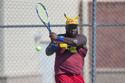 Alphonso Gordon of Meriden returns a volley from Ivanyuuk Yaro in the Mens B singles match Sunday during the Wayton Open Tennis finals at Southington High School in Southington Jul. 16, 2017 | Justin Weekes / For the Record-Journal