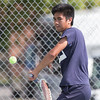 James Delgado 17 of West Haven plays a backhand volley in the high school boys match verse his brother Joseph Sunday during the Wayton Open finals at Southington High School in Southington Jul. 17, 2016   Justin Weekes / For the Record-Journal