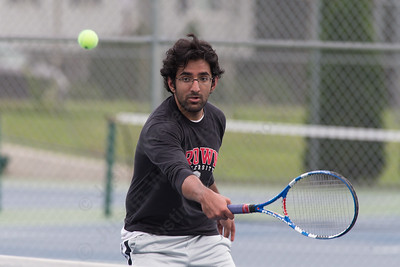 Usama Choudhry of Cheshire plays a back hand at the net in the mens B doubles match Wednesday during the Wayton Open at Southington High School in Southington Jul. 12, 2017 | Justin Weekes / For the Record-Journal