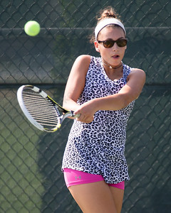 Samantha Barmore plays a backhand volley Sunday during the Wayton Open finals at Southington High School in Southington Jul. 17, 2016 | Justin Weekes / For the Record-Journal