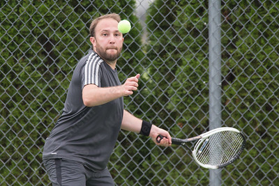 Phil Titolo of West hartford plays a forehand volley in a mixed doubles match Wednesday during the Wayton Open at Southington High School in Southington Jul. 12, 2017 | Justin Weekes / For the Record-Journal