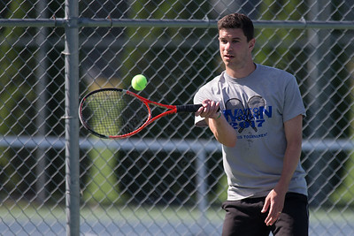 Mark Hubek plays a volley in the A doubles match Sunday during the Wayton Open Tennis finals at Southington High School in Southington Jul. 16, 2017 | Justin Weekes / For the Record-Journal