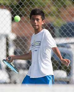 Joseph Delgado 14 of West Haven eyes a forehand volley in the high school match verse his brother James Sunday during the Wayton Open finals at Southington High School in Southington Jul. 17, 2016 | Justin Weekes / For the Record-Journal