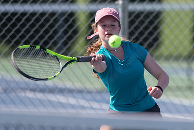Ellie Doolittle 15 of Berlin returns a serve in the womens singles match with Opal Bravo Sunday during the Wayton Open Tennis finals at Southington High School in Southington Jul. 16, 2017 | Justin Weekes / For the Record-Journal