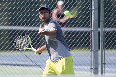 Kunal Kataria sets up for a forehand volley in the mens A match with Joe Albiach Sunday during the Wayton Open finals at Southington High School in Southington Jul. 17, 2016 | Justin Weekes / For the Record-Journal