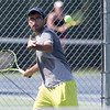 Kunal Kataria sets up for a forehand volley in the mens A match with Joe Albiach Sunday during the Wayton Open finals at Southington High School in Southington Jul. 17, 2016   Justin Weekes / For the Record-Journal