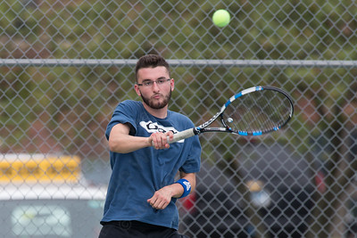 Turner Rodman of Southington returns a serve in the mens B doubles match Wednesday during the Wayton Open at Southington High School in Southington Jul. 12, 2017 | Justin Weekes / For the Record-Journal