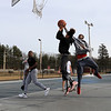 The weather has been much warmer the past few days in North Central MA, just right for a pick up basketball game with friends at Parkhill Park in Fitchburg, February 6, 2019. During the game Elijah Jeffreys, 14, tried to stop a shot by Izaak Rosado, 12. SENTINEL & ENTERPRISE/JOHN LOVE