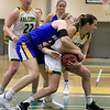 Worcester State University women's basketball played Fitchburg State University on Saturday, January 19, 2019 at their Recreation Center. FSU's Hannah Keohan and WSU's Sarah Blomgren fight for control of the ball. SENTINEL & ENTERPRISE/JOHN LOVE