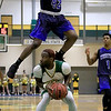 Fitchburg State University men's basketball played Westfield State University on Wednesday afternoon at FSU's Recreation Center. FSU's Anselm Edegbe makes a move that made WSU's Justin Rennis have to leap over him during action in the first half of the game. SENTINEL & ENTERPRISE/JOHN LOVE