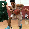 Nashoba Regional High School boy's basketball played Fitchburg High School on Thursday night in Fitchburg. FHS's Luis Aldarondo drives to the basket by NRHS's Andrew Ahlquist. SENTINEL & ENTERPRISE/JOHN LOVE