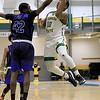Fitchburg State University men's basketball played Westfield State University on Wednesday afternoon at FSU's Recreation Center. FSU's Tyrell St. John gets his shot blocked by WSU's Justin Rennis. SENTINEL & ENTERPRISE/JOHN LOVE