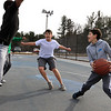 The weather has been much warmer the past few days in North Central MA, just right for a pick up basketball game with friends at Parkhill Park in Fitchburg, February 6, 2019. Jayden Rodriguez, 12,looks for a way to the basket while being covered by Patriot Gillman, 14, and Isaiah Jeffreys, 14 on left. SENTINEL & ENTERPRISE/JOHN LOVE