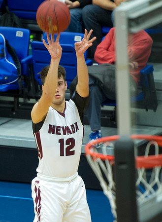 Nevada's Braeden Hinton (12) puts a shot up behind the arc during their semifinal game of the Carthage High School Invitational against Carthage on Friday night at CHS.<br /> Globe | Laurie Sisk
