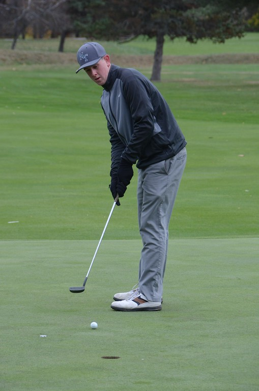 . Brian Boudreau of McCann Technical High School putts it at the 18th hole during the Western Mass Division 3 Golf State Qualifier at the Wyantenuck Country Club in Great Barrington on Tuesday, October 25, 2016. Gillian Jones � The Berkshire Eagle | photos.berkshireeagle.com