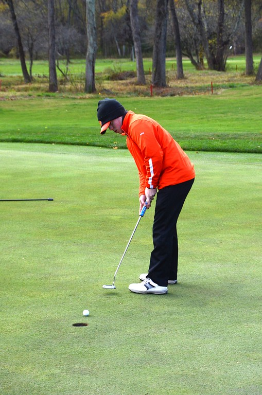 . Bryce Whalen of Lee putts it in at the 13th hole during the Western Mass Division 3 Golf State Qualifier at the Wyantenuck Country Club in Great Barrington on  Tuesday, October 25, 2016. Gillian Jones � The Berkshire Eagle | photos.berkshireeagle.com