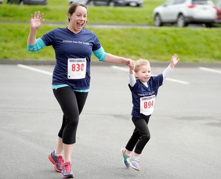 BEN GARVER — THE BERKSHIRE EAGLE<br /> Anna , 4, and and Kelly Kennedy finnish the 41st Annual Women's Running Race at Berkshire Community College in Pittsfield.