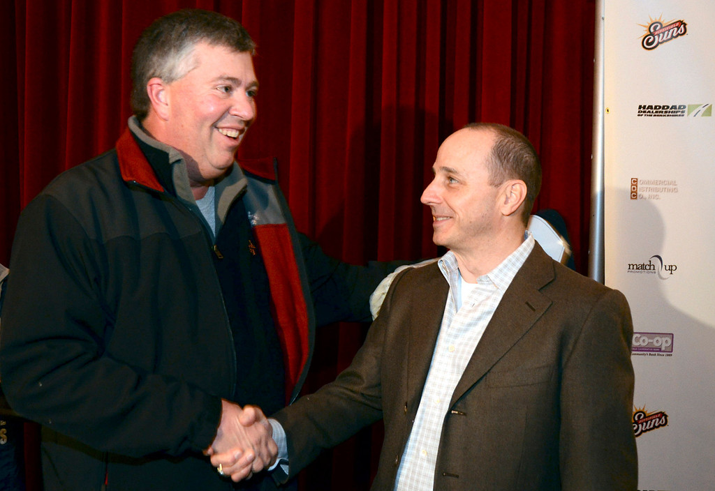 . Yankees Fan Cliff Briggs of Great Barrington shakes hands after having his Yankee All-Star hat signed by New York Yankees General Manager Brian Cashman during a meet and greet and The Colonial Theater in Pittsfield on Thursday, Jan. 30, 2014. Gillian Jones/Berkshire Eagle Staff