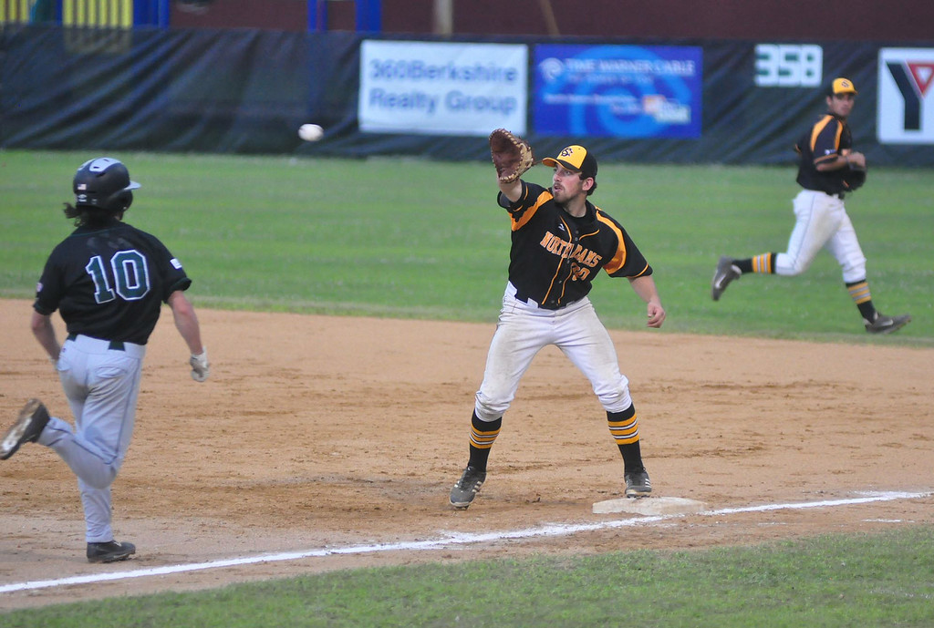 . North Adams\' Matthew Schmidt gets ready to catch the ball and tag out Vermont\'s Jack Parenty on first base during a game at Joe Wolfe Field in North Adams on Tuesday, July, 15, 2014. Gillian Jones / Berkshire Eagle Staff / photos.berkshireeagle.com