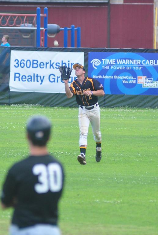 . SteepleCats\' center fielder Thomas Delph catches a fly ball. Gillian Jones / Berkshire Eagle Staff / photos.berkshireeagle.com