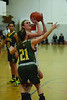 Greylock's Mackenzie Flynn tries to make a basket while Taconic's Kirsten McNiece blocks her. (Gillian Jones/North Adams Transcript)