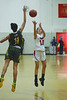Greylock's Arianna Walden shoots as Taconic's Shalee Conyers tries to block. (Gillian Jones/North Adams Transcript)
