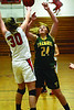 Greylock's Jenna Benzinger and Taconic's Brianna Rogers try to gain possession of the ball on the rebound. (Gillian Jones/North Adams Transcript)