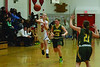 Greylock's Mackenzie Flynn tries to pass the ball past Taconic's Shea Hassett, center, and Kirsten McNiece. (Gillian Jones/North Adams Transcript)