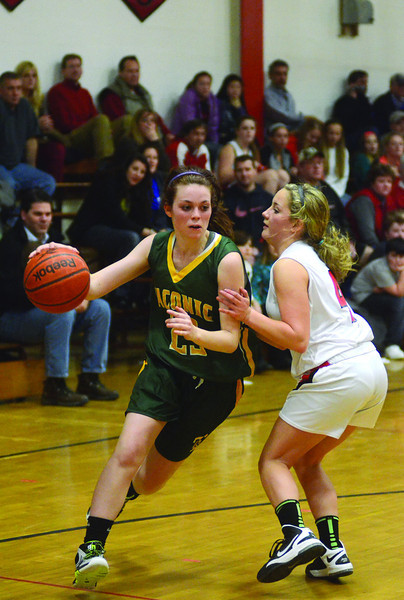 Taconic's Angela O'Neil manuevers around Greylock's Julia Vlahopoulos. (Gillian Jones/North Adams Transcript)