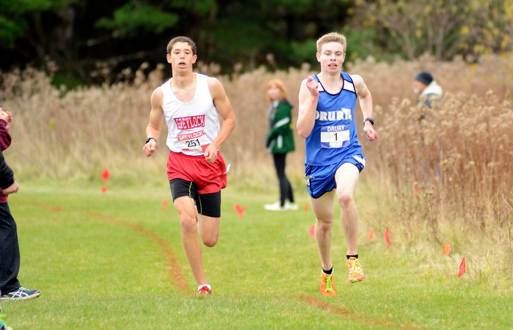 . Drury\'s Connor Meehan (right) passes Mount Greylock\'s Jacob Fink down the final stretch of the Berkshire County Championships boys varsity race. Meehan held off Fink to take first place overall on Saturday at Berkshire Community College.